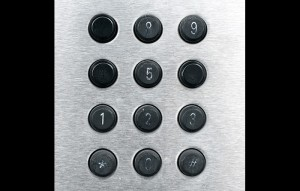 Worn numbers on a phone keypad