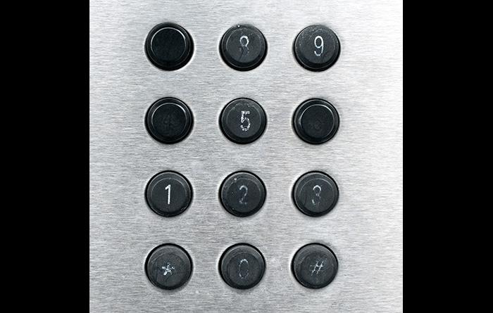 Worn numbers on a phone keypad